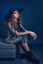Sitting Brooding Girl In A Hat