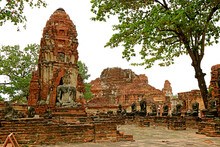 Group Of Buddha Image Ruins In Wat Mahathat Temple Or The Monastery Of The Great Relic In Ayutthaya Historical Park, Thailand
