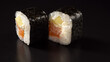 sushi maki two pieces with salmon, cucumber and cheese