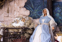 Nativity Scene - Beautiful Statues Of The Virgin Mary And Baby Jesus In A Manger. Christmas Holiday