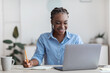Online Education. Young Black Female Student Using Laptop At Home, Taking Notes