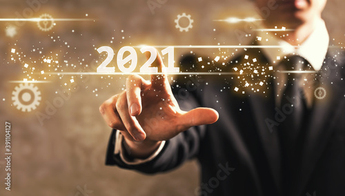 Fotografie, Obraz 2021 text with businessman on dark vintage background