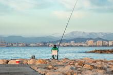 Fisherman On The Beach - Fishe...
