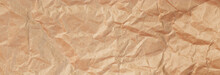Background Of Crumpled Craft Paper For Packaging. Banner