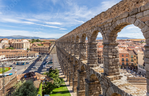 Obraz na plátně Roman aqueduct bridge and city panorama, Segovia, Spain