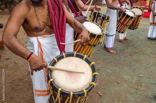 Fotografiet Indian men play traditional percussion drum Chenda in Kerala, India