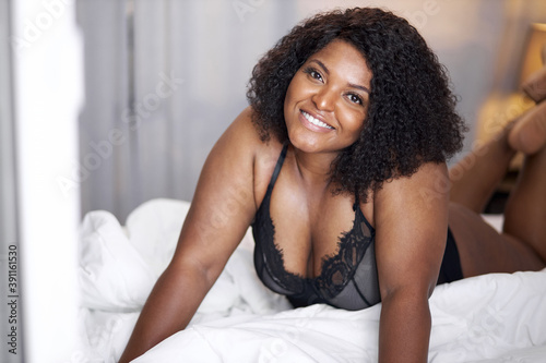 Fotografie, Obraz passionate ardent african woman have relax time on bed, black lady enjoy, has pe