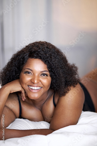 Fototapeta afro american overweight woman enjoy weekends at home on bed, every morning is good