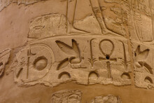 Egyptian Ancient Hieroglyphs On The Stone Wall. Closeup Of The Symbol Of Eternal Life Ankh