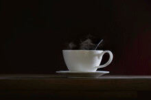 Coffee In White Cup Put On Sau...