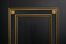 Classic Black Wooden Entrance Door With Carved Panels And Golden Patina