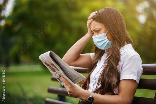 Businesswoman is on break. She is reading news and getting worried.