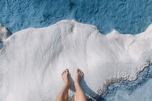 Men's Feet On White Calcite Tr...