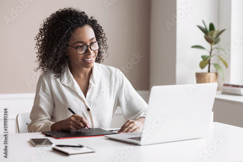 Young woman using laptop computer at office Fototapeta