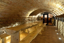 Climate Controlled Wine Cellar, With A Domed Brick Ceiling And Walls, Stacked Benches
