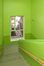 Green Painted School Stairwell And View Into Courtyard