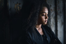 Portrait Of Sad Mixed-race Teenager Girl Standing Indoors In Abandoned Building.