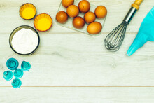 Copy Space With Eggs And Flour And Cupcake Mold Piping Bag On Wood Table With Copy Space