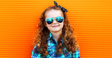 Portrait Of Little Girl Child Wearing A Checkered Shirt, Sunglasses Over Pink Background