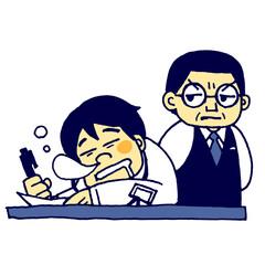 仕事中に居眠りをする若い男性社員