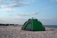 Green Tent On The Sandy Shore ...