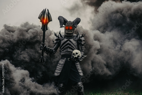 Mutant warrior stands with glowing eyes against a background of black smoke Fototapeta