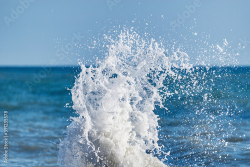 Wave of the sea water at sunny day time.