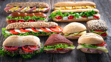 Assorted Sandwiches On Wooden ...