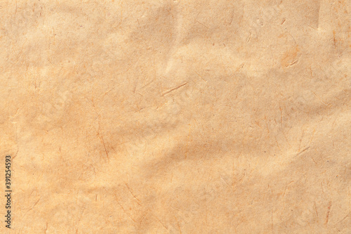 Texture of beige old paper crumpled background. Vintage grunge surface backdrop.