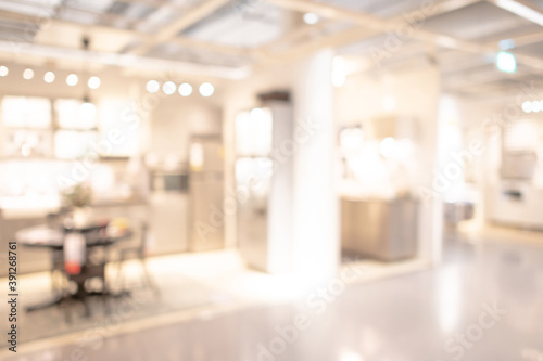 Abstract blur interior design showroom in shopping mall. Blurred furniture retail in department store. Defocused bokeh effect background or backdrop for business concept.