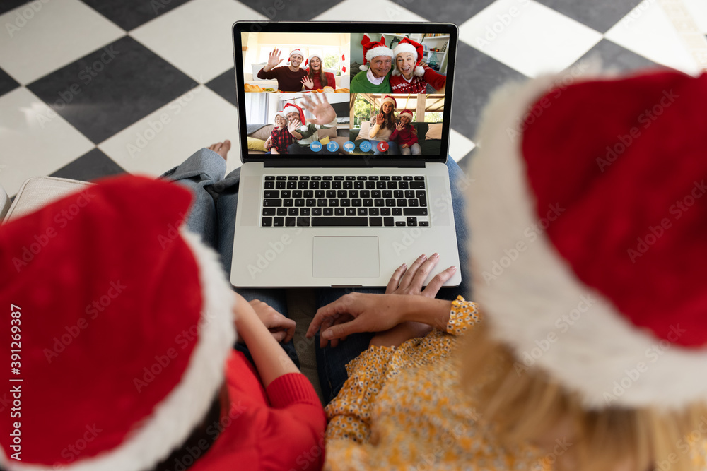 Fototapeta Caucasian woman and her child at christmas on a video call