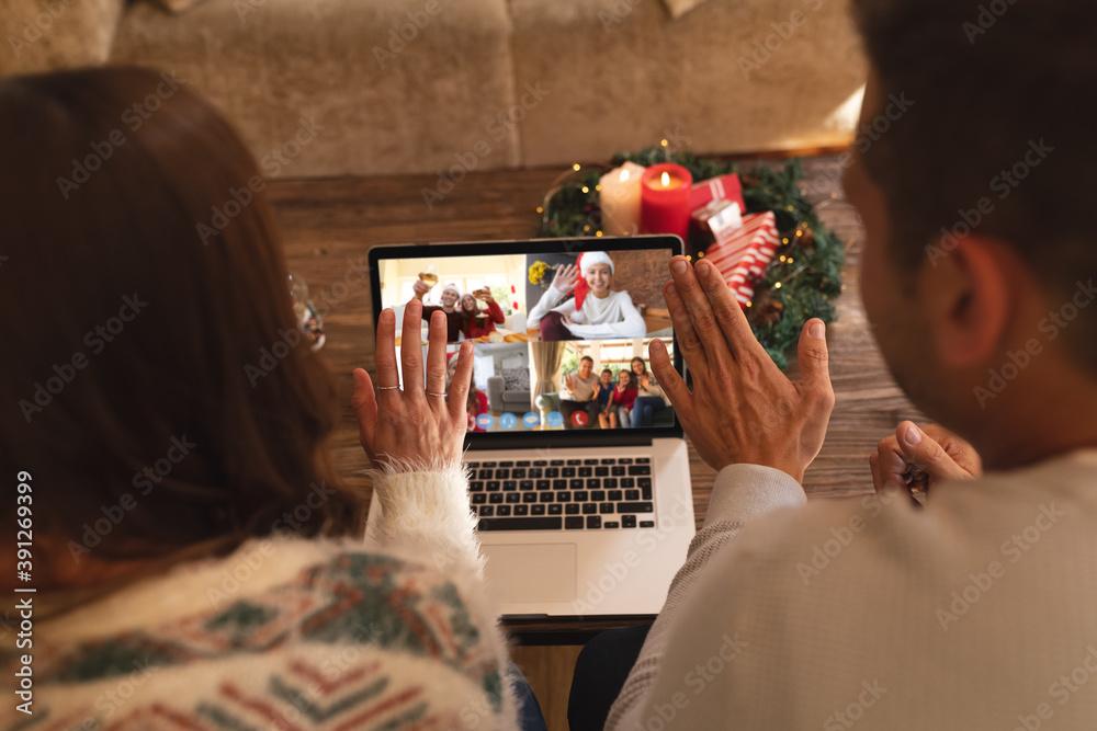 Fototapeta Caucasian couple at christmas on a video call