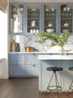 3d rendering of a light blue rustic country kitchen with white marble backsplash, an island and vintage stools, vertical closeup