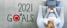 2021 Goals With Man Using A Laptop In A Modern Gray Chair