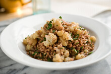 Close Up Of Barley Risotto With Cauliflower And Wine