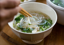 Asian Soup In Bowl With Chicke...