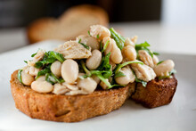 Close Up Of Bruschetta With Arugula, Tuna And Bean
