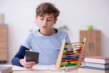 Schoolboy With Abacus Studying...