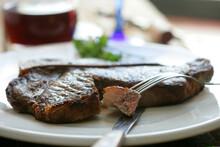 Broiled Rib Eye Steak On Plate