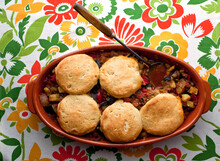 Close Up Of Ratatouille And Sausage Pot Pie With Cornmeal Biscuits