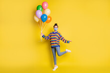Full Size Photo Of Brunette Girl Hold Balloons Wear Blue Mask From Corona Rainbow Sweater Isolated On Bright Yellow Background