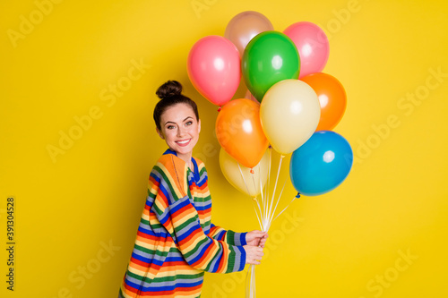 Photo of joyful young woman adore hold balloons beaming smile isolated on bright Canvas Print