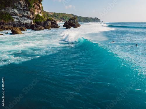 Barrel blue wave in ocean and cliff at background Tapéta, Fotótapéta