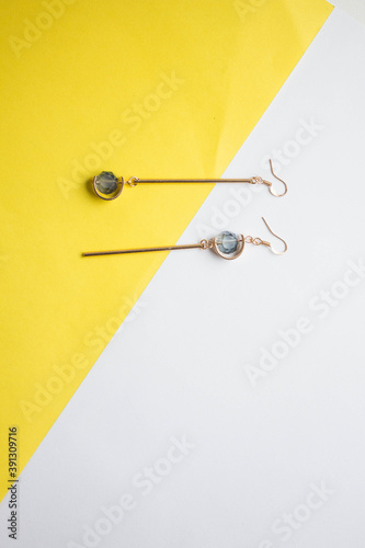 Silver jewelry on minimal yellow background. minimal art Fototapeta