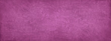 Pink Purple Abstract Background. Toned Texture Of Rough Decorative Plaster On A Concrete Wall. Wide Banner. Panorama. Copy Space. Nobody. Fuchsia Color Background With Grungy Texture.