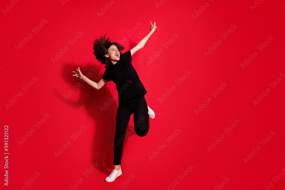 Leinwandbild Motiv - deagreez : Photo portrait full body view of crazy girl dancing standing on one leg isolated on vivid red colored background