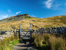 A Stone Path With A Gate Takes The Hiker Up To The Mountain Of Pen-y-ghent In The Yorkshire Dales National Park. At 2,277 Feet, The Mountain Is One Of The 'Three Peaks Of Yorkshire'.