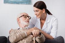 Geriatric Nurse And Aged Man L...