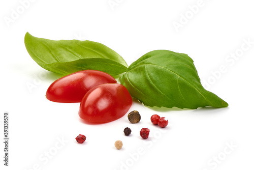Fotografiet Fresh cherry tomatoes with basil leaves, isolated on white background