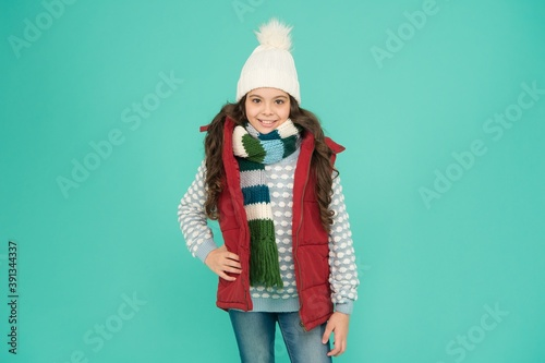 Fotografija happy teen girl with long curly hair wear puffer waistcoat and knitwear on chris